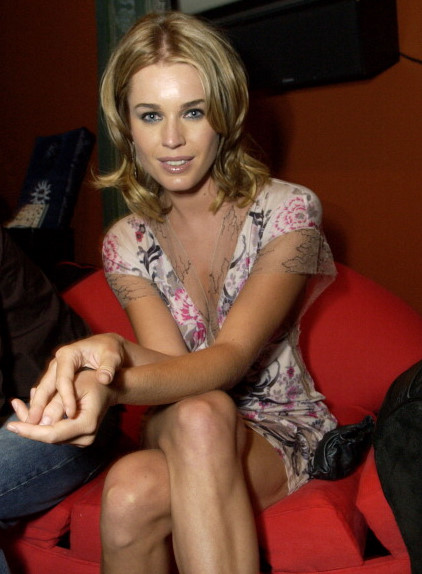 "Rebecca Romijn Stamos sitting on the Mckinley Pierre ""Horizon"" chair"
